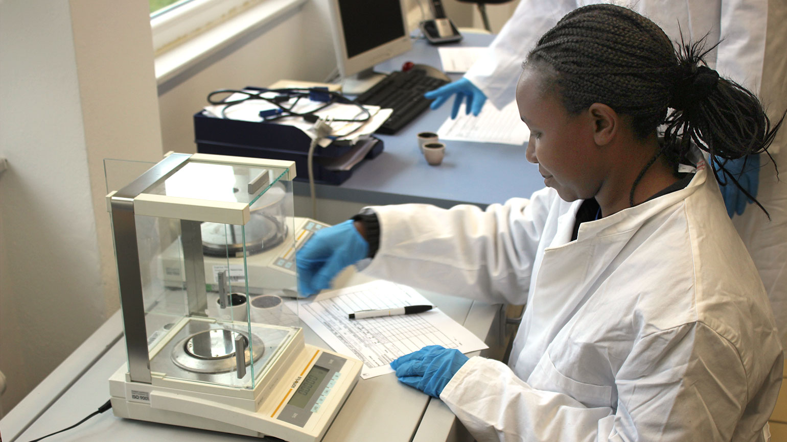 woman from Africa working in a lab