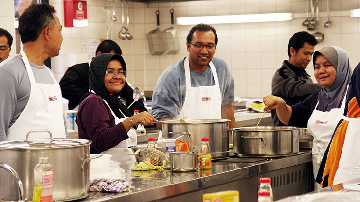 Malaysian trainers cooking together