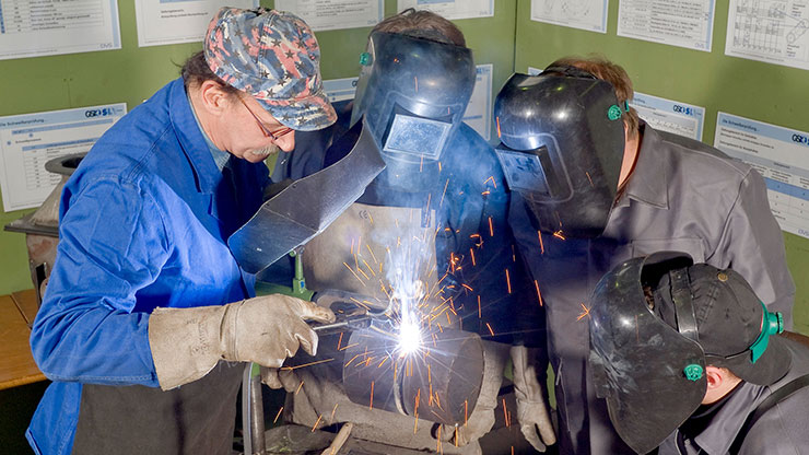trainees practice welding
